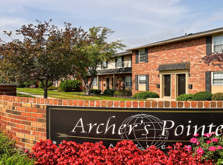 Community Entrance at Archer's Pointe with brick sign and flower beds.