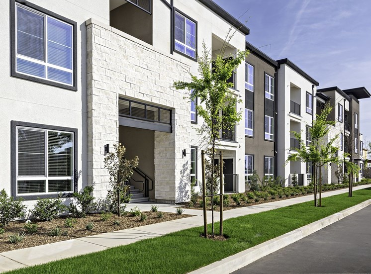 Exterior Photo of The Row Apartment Homes with Landscaping