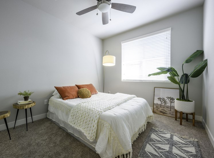 Bedroom with Bed and Fan
