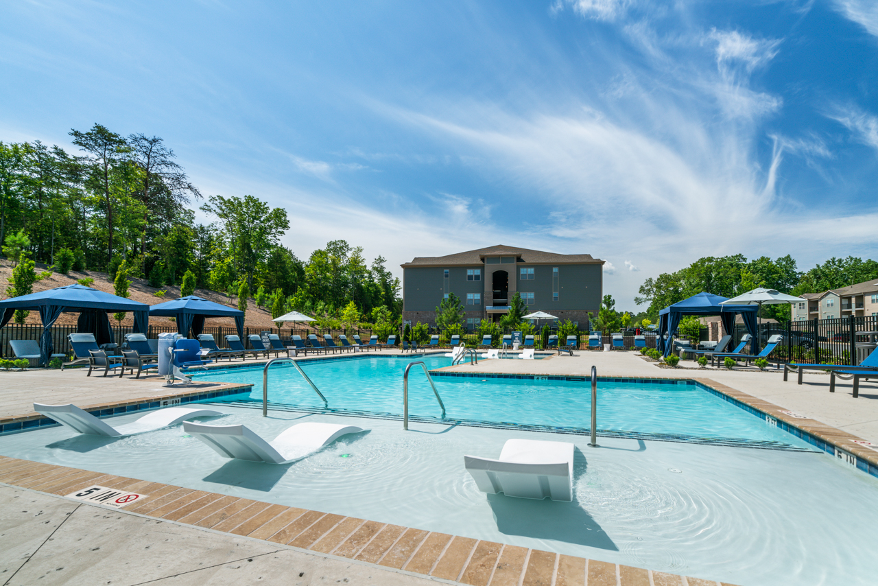 Sparkling swimming pool with a spacious sundeck at The Lodges at Lake Wylie in Lake Wylie, SC