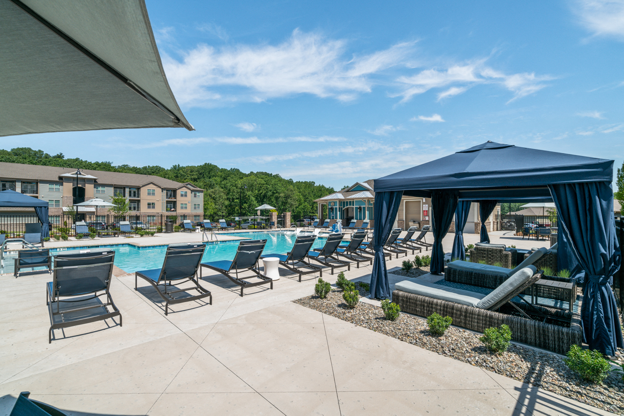 Poolside cabanas and lounge chairs at The Lodges at Lake Wylie in Lake Wylie, SC
