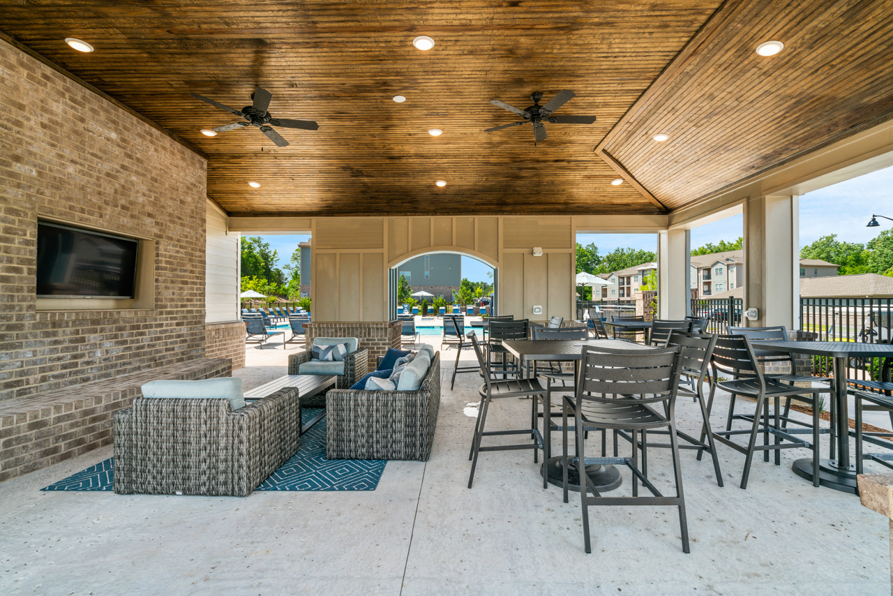 Flat screen TV and outdoor lounge at The Lodges at Lake Wylie in Lake Wylie, SC