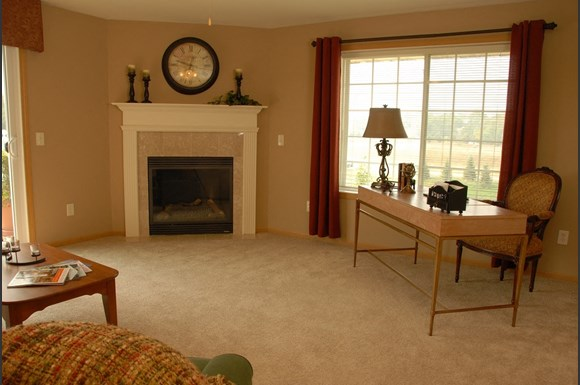 Living Rooms With Fireplace at Wildwood Highlands Apartments & Townhomes 55+, Menomonee Falls, WI,53051