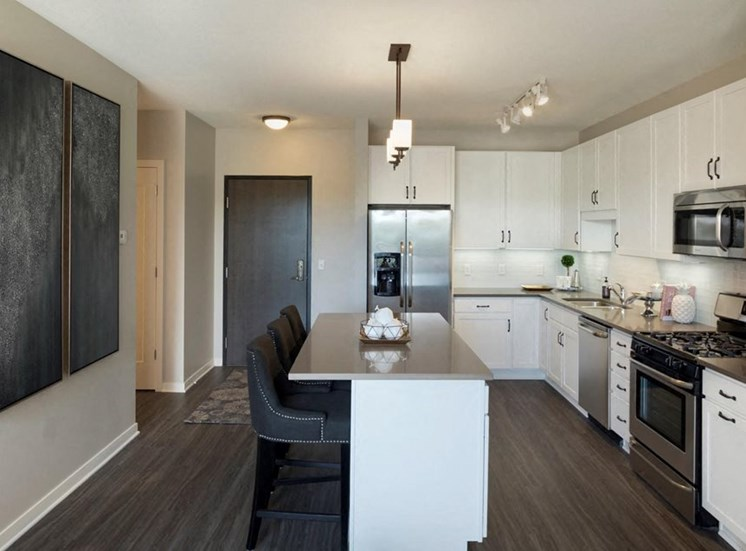 Kitchen With White Cabinetry And Black Appliances Residences at 1700 Model Kitchen