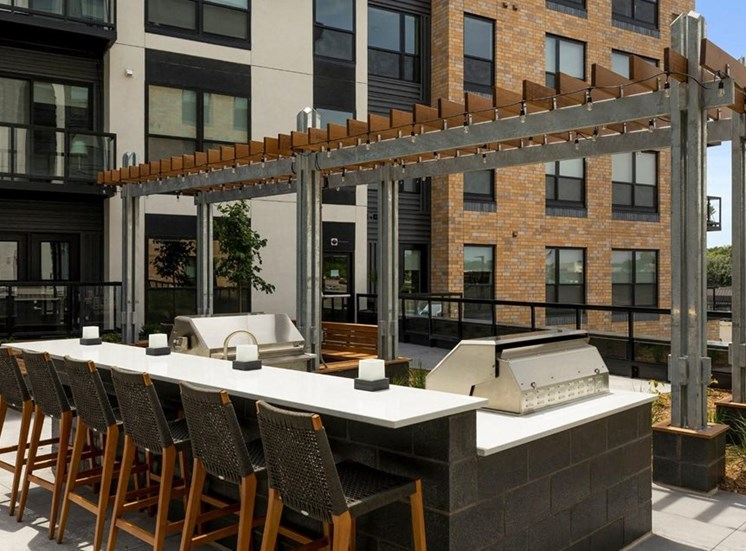 Outdoor Kitchen and Lounge Area Residences at 1700 Outdoor Pool Sun Deck Grilling Area