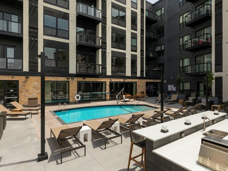 Residences at 1700 Outdoor Pool Sun Deck Grilling Area