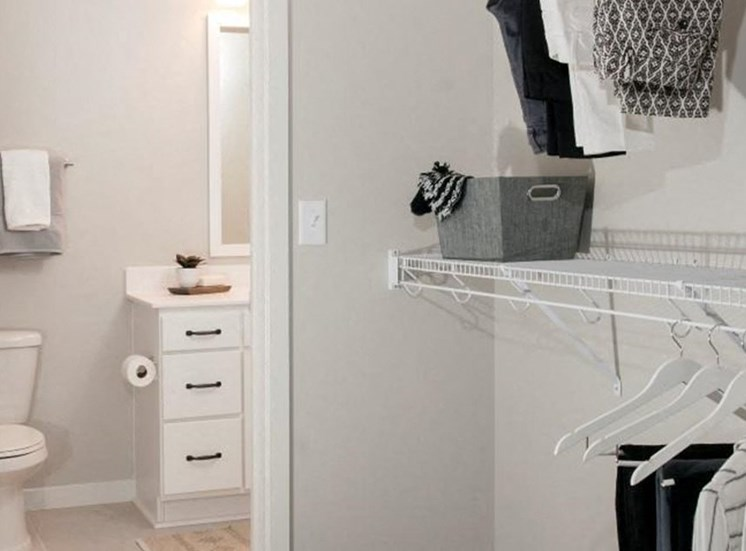 Walk-In Closets With Built-In Shelving Residences at 1700 Model Bathroom Bedroom Closet