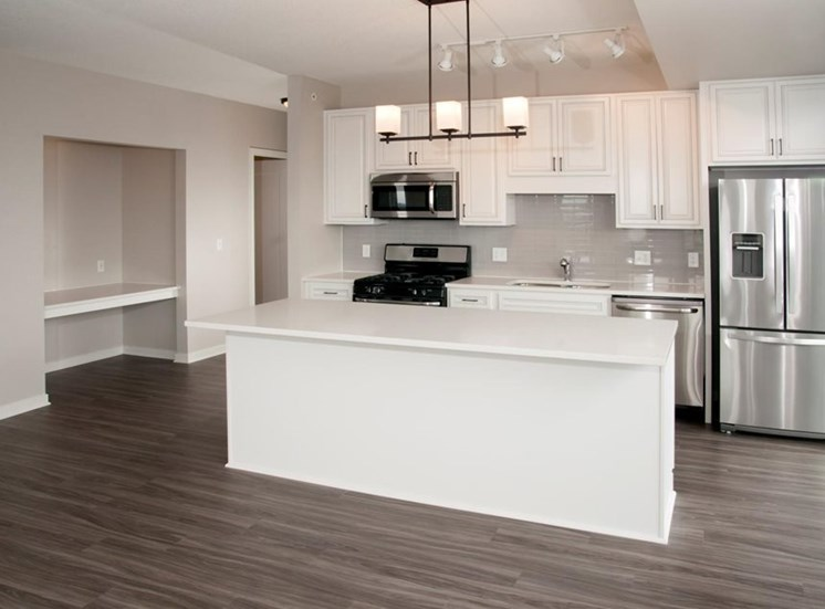Faux Wood Flooring Residences at 1700 Vacant Kitchen