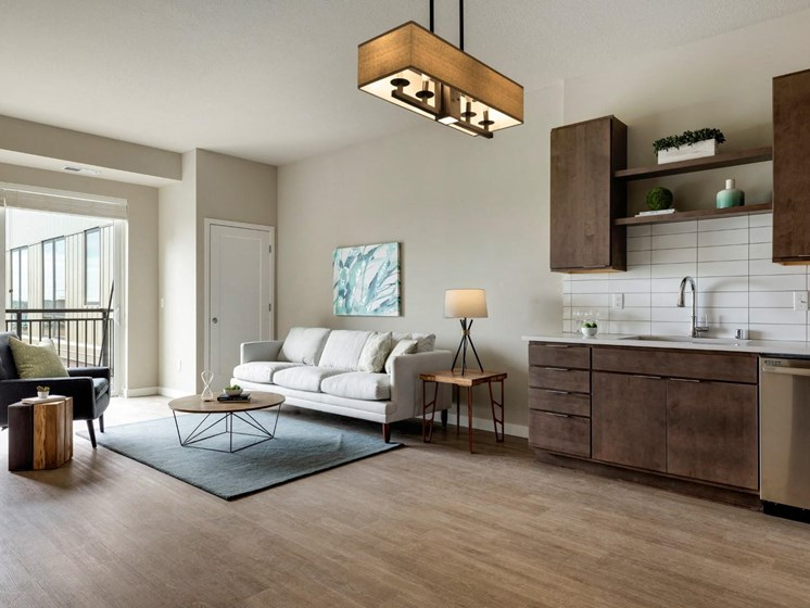 Kitchen and Living Room Space at The M on Hennepin Apartments in Minneapolis, MN