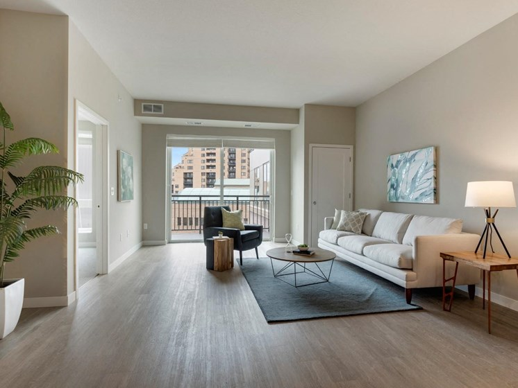 Modern Living Room With Decor at The M on Hennepin Apartments in Minneapolis, MN