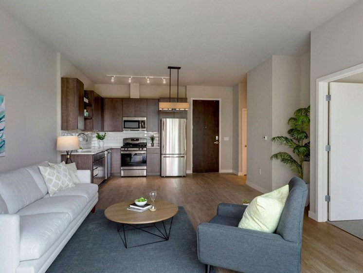 Living Room and Kitchen Area with Hardwood Flooring at The M on Hennepin Apartments in Minneapolis, MN