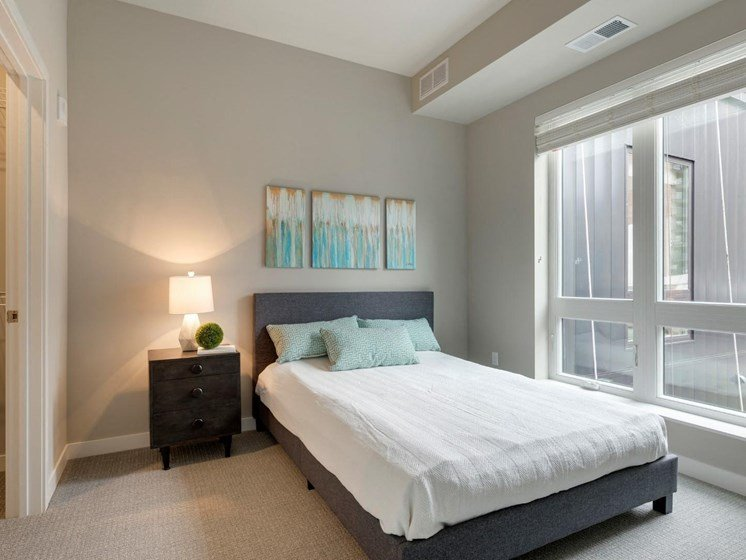 Bedroom With Plenty of Natural Light at The M on Hennepin Apartments in Minneapolis, MN
