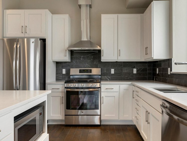 Kitchen With White Cabinetry at The M on Hennepin in Minneapolis, MN