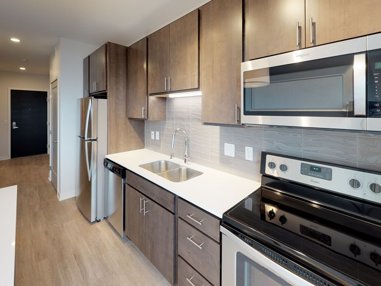 Model Kitchen with Slate Cabinets in Hue Alcove at Mezzo Apartments in NE Minneapolis