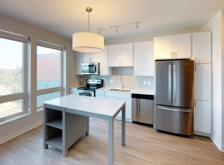 Model Kitchen with White Cabinets in Hue Alcove at Mezzo Apartments in NE Minneapolis