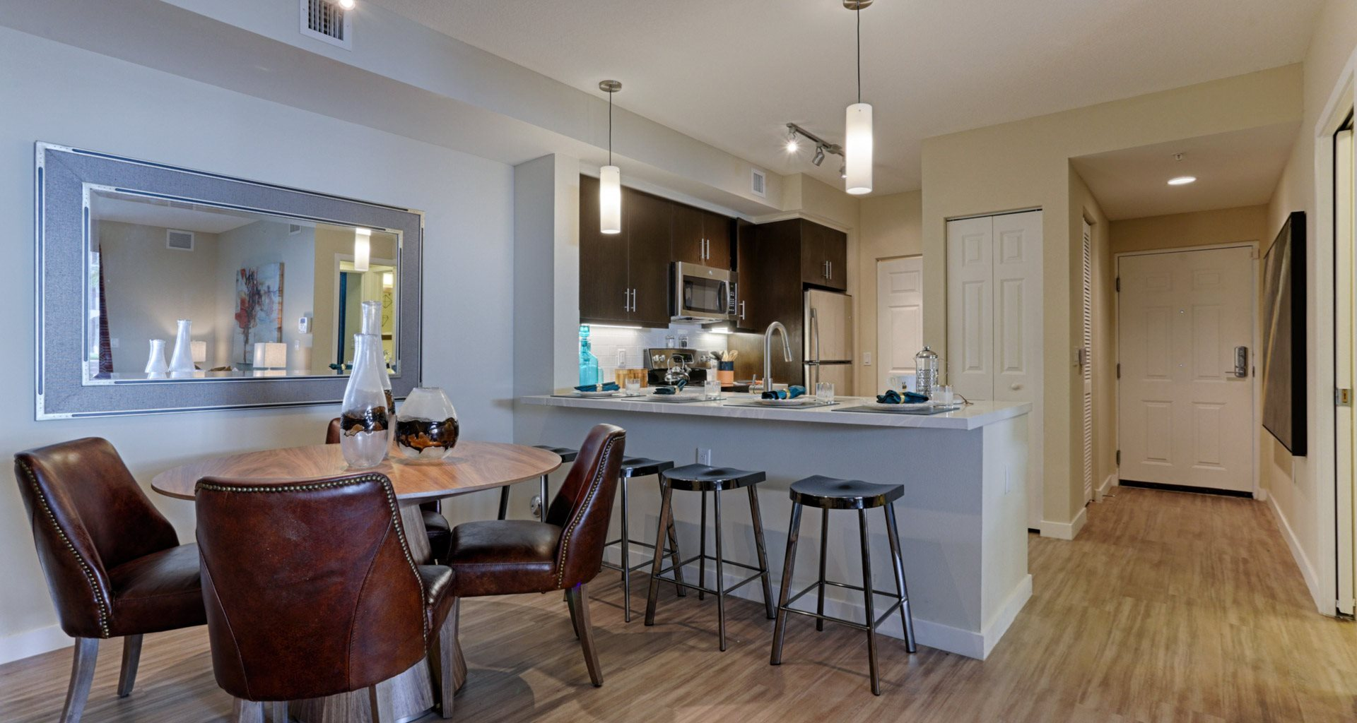Kitchen with Breakfast Bar at Mirador at Doral by Windsor, Doral, FL, 33122