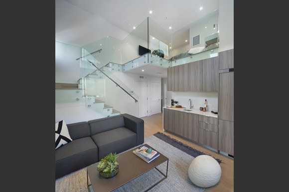 Furnished-Apartment-mysuite-at-acacia-Interior-living-room-Loft-With-Staircase-Decor-Wet-bar-Amenities-Product.jpg