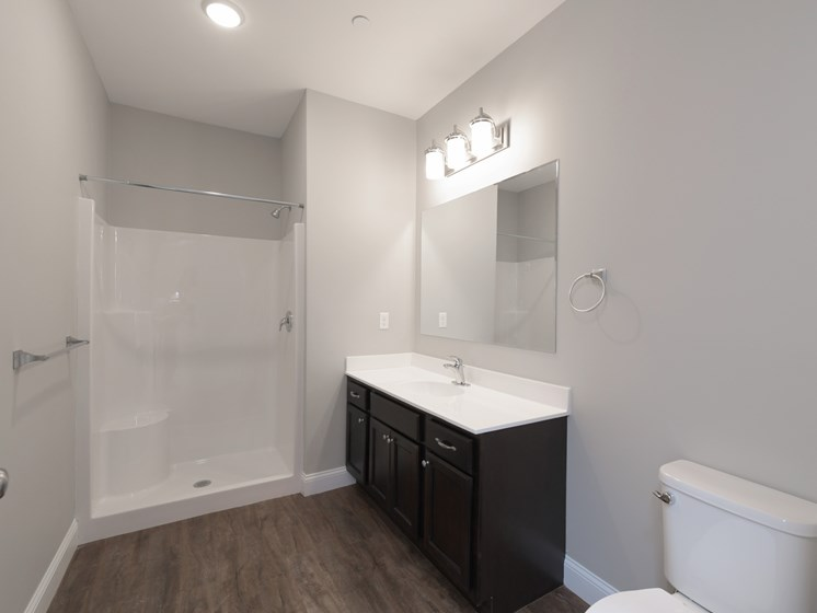 Spacious Bathrooms with Wood Flooring and Large Vanity Area at Webster Village, Hanover, MA