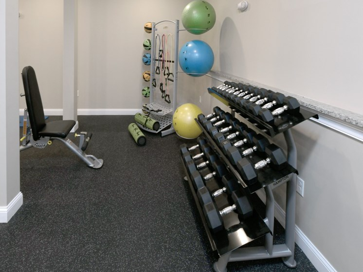 Free weights inside fitness center at Webster Village, Hanover, Massachusetts