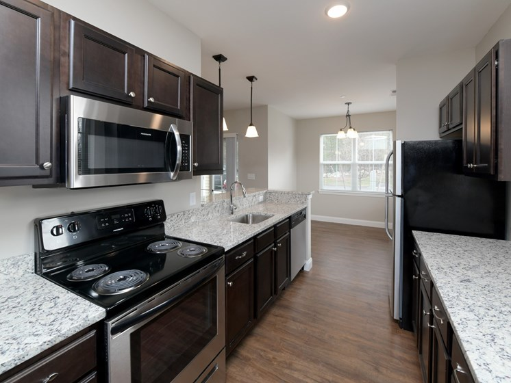 Luxurious fully-equipped kitchens with stainless steel appliances at Webster Village, Hanover, MA, 02339