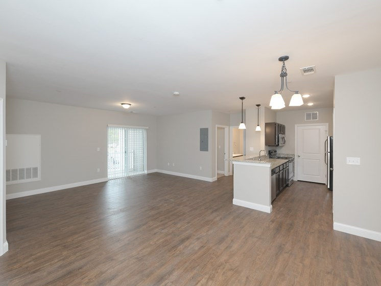 Open floor layout of living, kitchen, and dining areas at Webster Village, Hanover, MA 02339