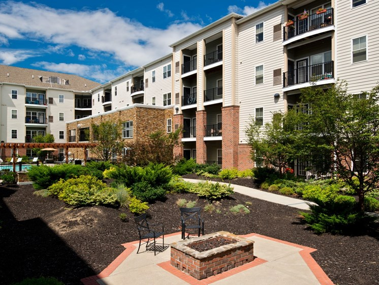 Outdoor courtyards with gas grills and fire pits at Alexander at Patroon Creek, Albany, New York