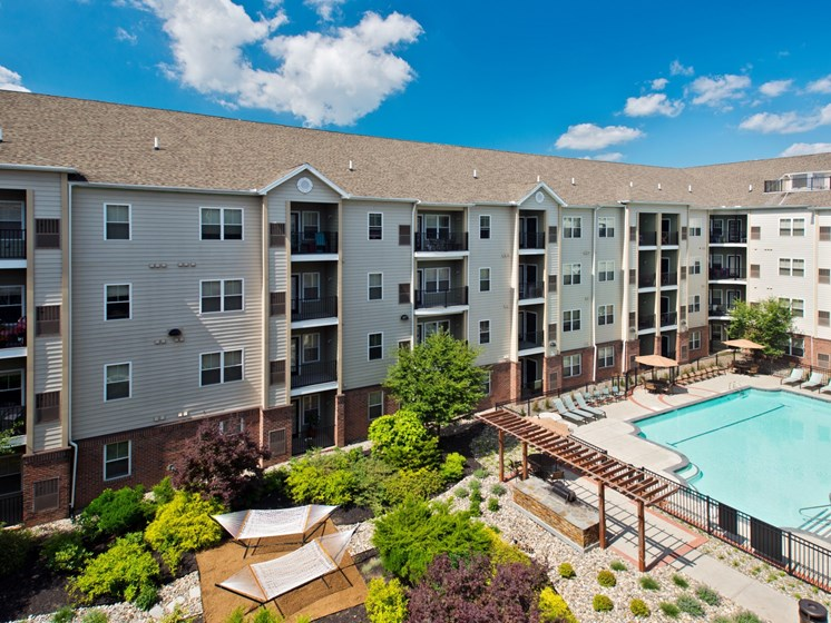 View of apartment complex and outdoor pool at Alexander at Patroon Creek, Albany