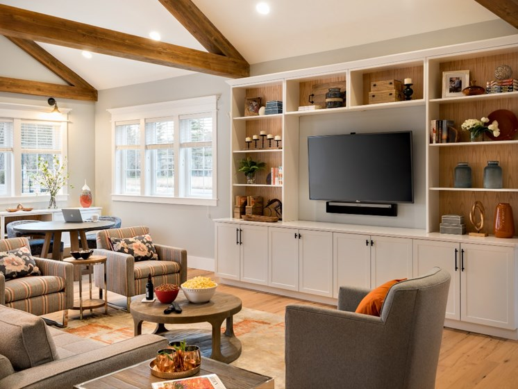 Clubhouse with TV and lounge areas at East Main Apartments in Norton, Massachusetts, 02766