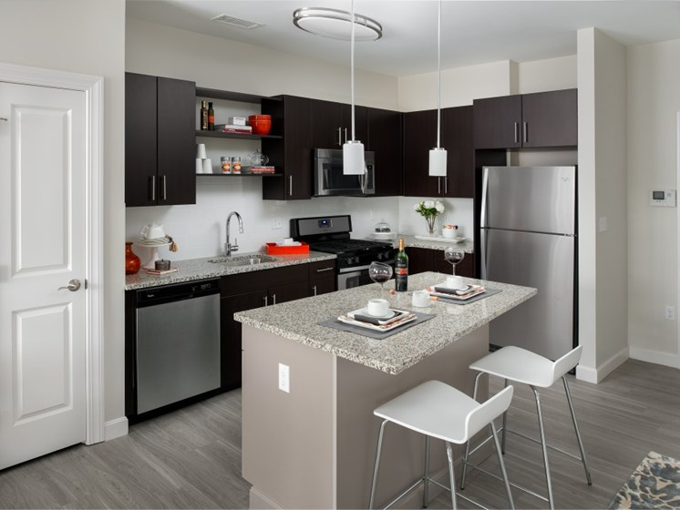 Modern kitchen with stainless steel gas appliances at East Main Apartments, Massachusetts, 02766