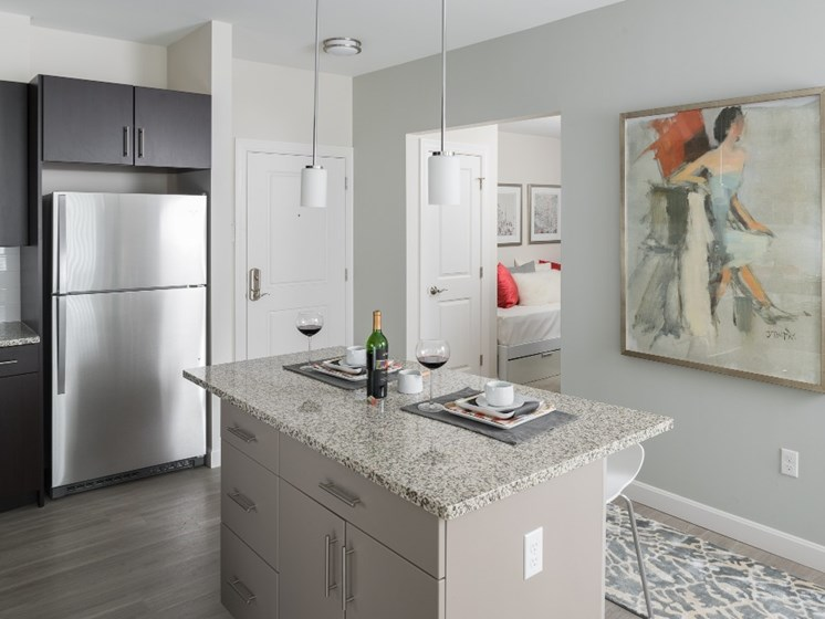 Contemporary Kitchen with Granite Countertops and Stainless Steel Appliances at East Main Apartments, Norton, MA, 02766