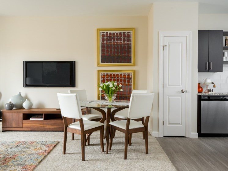 Open floor plan layout of living and dining areas at East Main apartments, Norton, 02766