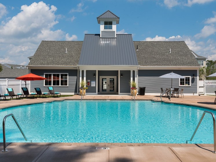 Swimming pool with sundeck and pool house at East Main Apartments in Norton, Massachusetts
