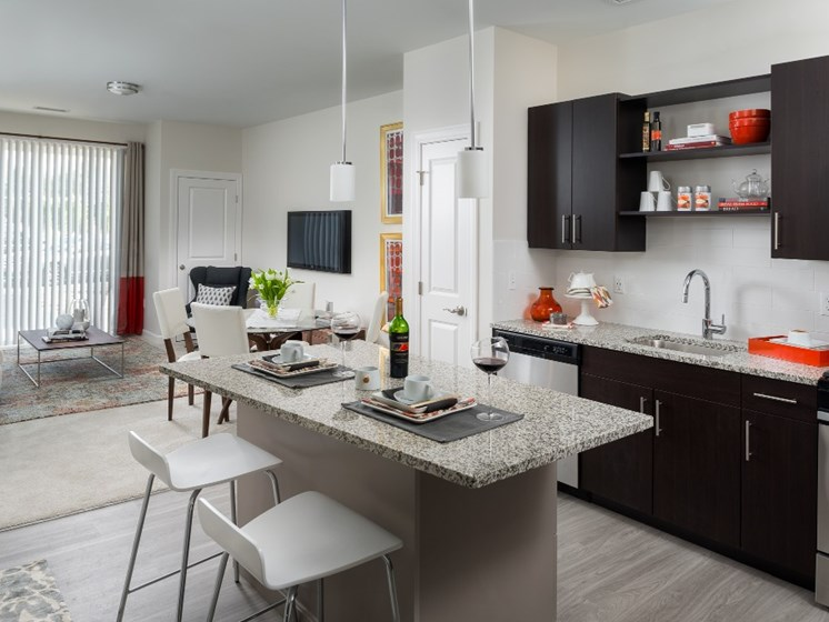Designer two-tone kitchens with islands for entertaining and stainless steel appliances at East Main, Norton
