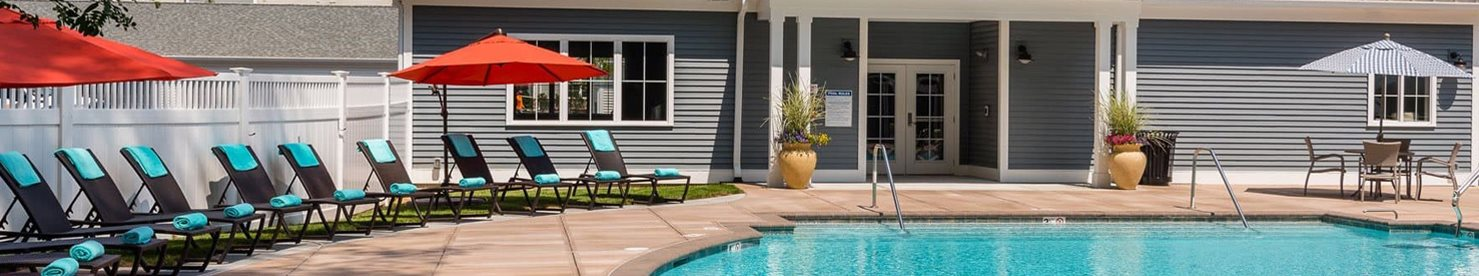 Pool Side Relaxing Sundeck Area at East Main Apartments in Norton