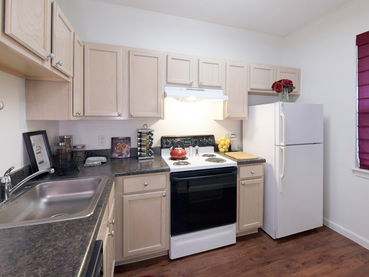 L-Shaped Kitchen with Wood Flooring at Cumberland Crossing, Cumberland, RI