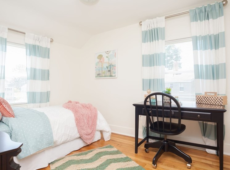 Spacious bedroom with wood flooring and ceiling light at Redbank Village, South Portland, ME, 04106