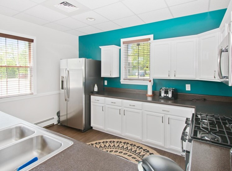 Clubhouse kitchen with extra storage cabinet space at Redbank Village, South Portland, 04106