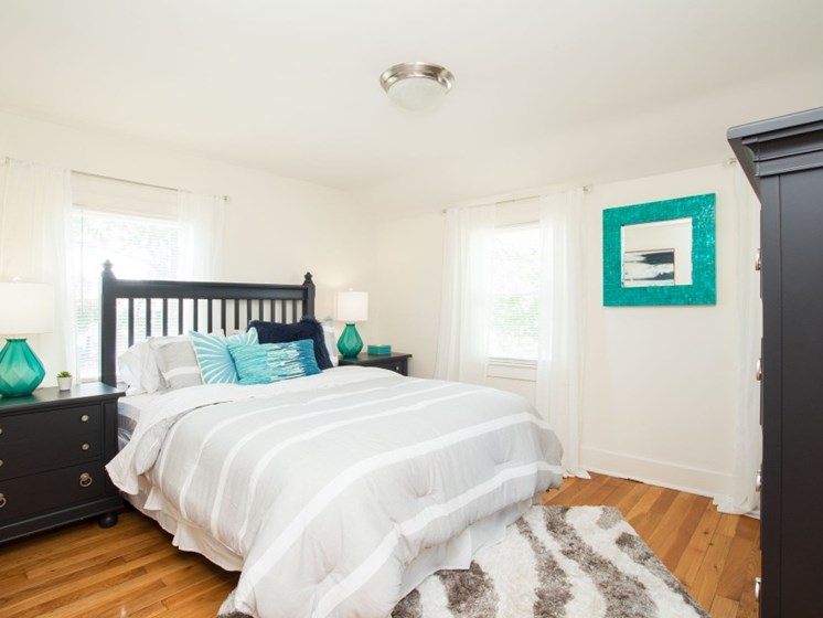 Classic Bedroom with wood flooring and ceiling light at Redbank Village, Maine
