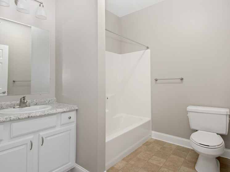 Spacious Bathrooms with Tub, Tile Flooring, and Vanity Area at Liberty Commons, South Portland, ME, 04106
