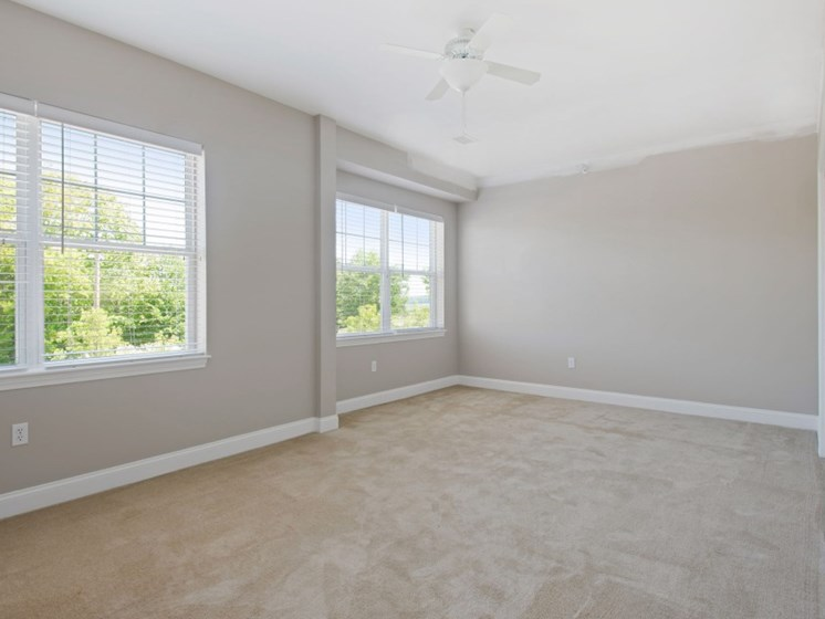 Spacious bedrooms with large closets, multiple windows, and carpeting at Liberty Commons, South Portland, 04106