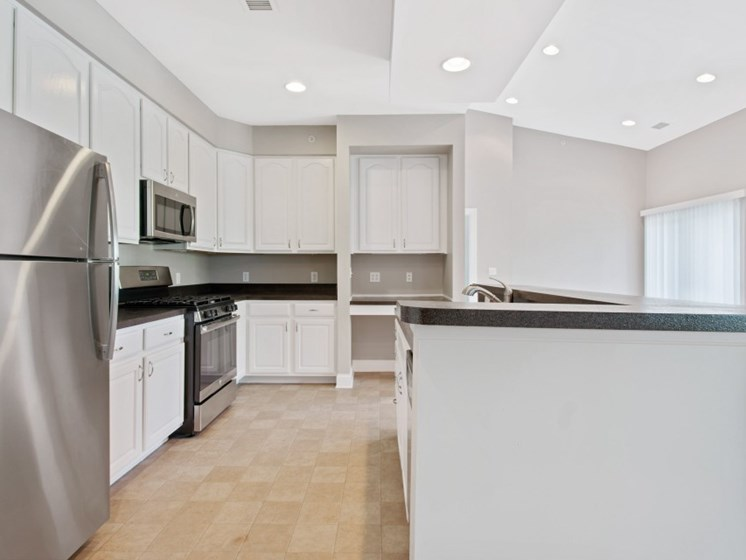 Fully-equipped kitchens with stainless steel appliances at Liberty Commons, South Portland, Maine