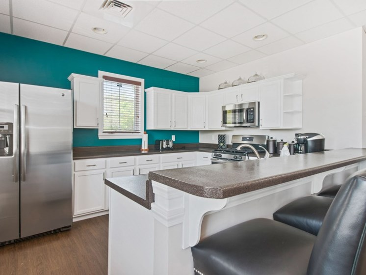 Fully-Equipped Clubhouse Kitchen with Breakfast Bar at Liberty Commons, South Portland, 04106