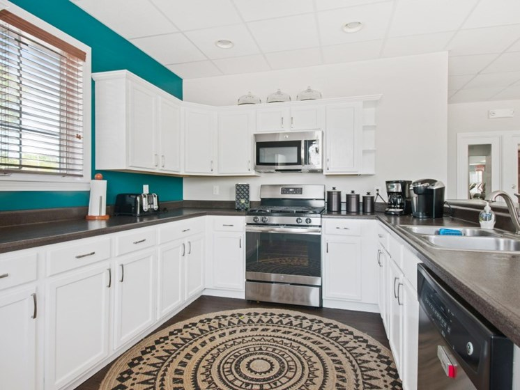 Fully Equipped Clubhouse Kitchen with Stainless Steel Appliances at Liberty Commons, South Portland