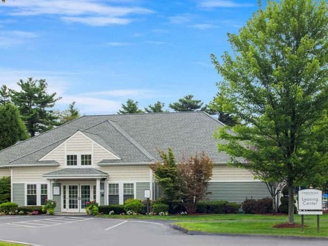 Exterior shot of leasing and clubhouse building at Union Place, Franklin, MA