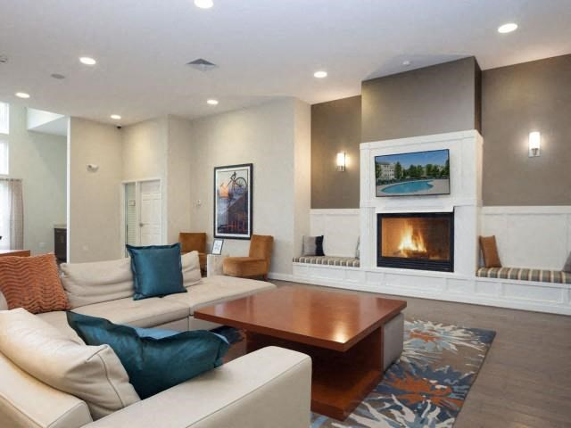 Luxurious Clubhouse with Lounge Areas, TV, and Fireplace at Union Place, Franklin, MA