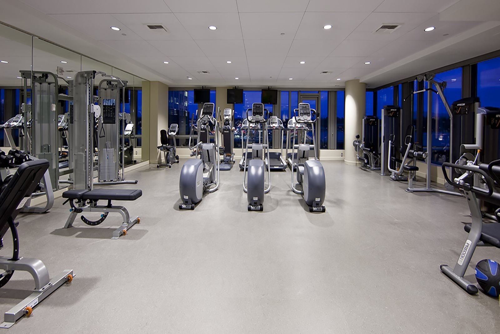 Fitness Center with Floor-to-Ceiling Windows at The Bravern in Bellevue, WA