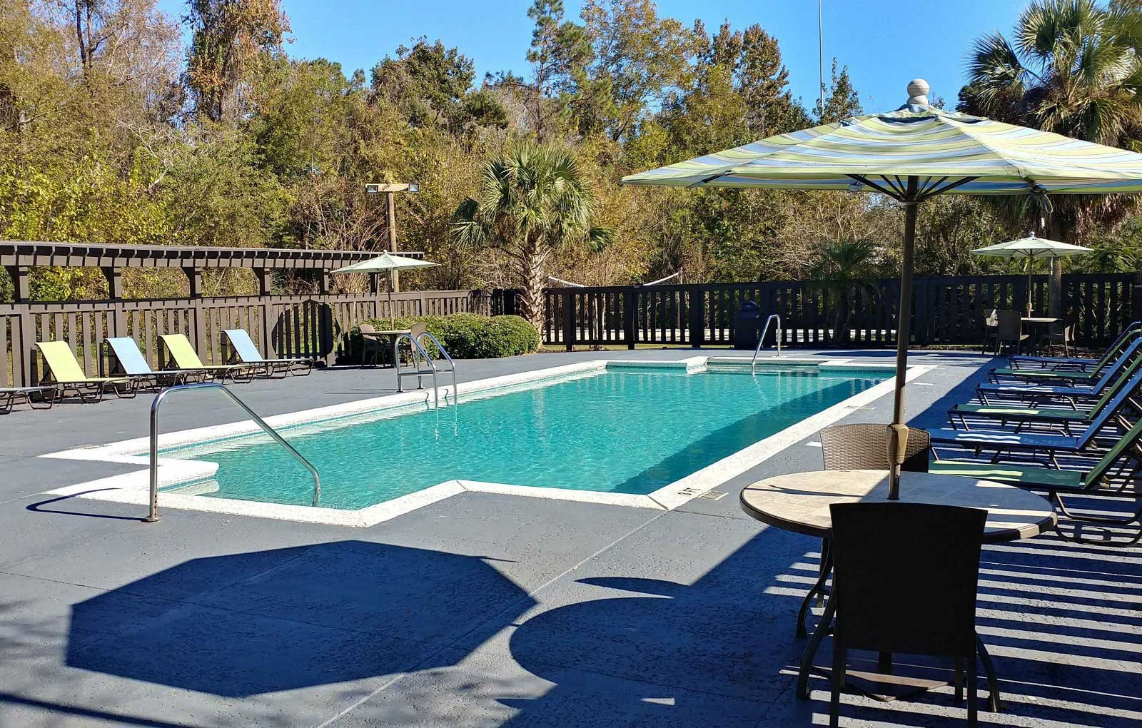 PoolSide Lounge Chairs at Springwood Townhomes Apartments, Tallahassee, FL, 32303