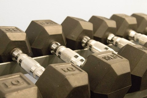 Fitness center with dumbells