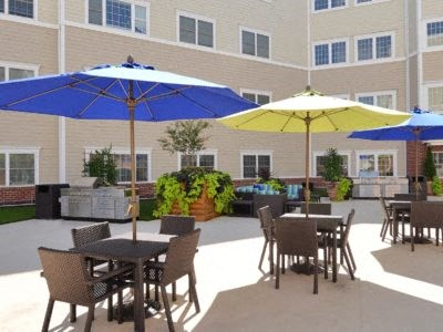 Community Courtyard with outdoor dining area with umbrellas