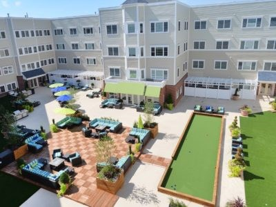 Community Courtyard with bocce ball court and lounge seating